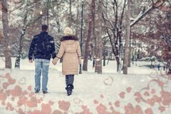 Valentines holiday - young couple having a walk in winter park royalty free stock photos