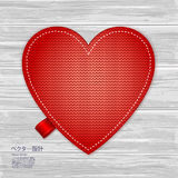 Valentines kniited heart on a wood background Royalty Free Stock Images