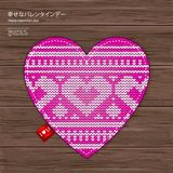 Valentines kniited heart on a wood background Royalty Free Stock Photography