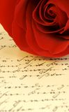 Valentines love letter II. Red rose on vintage letter in German royalty free stock photography