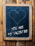 Valentines message on a school slate. Valentines message on an old retro school slate in a rustic weathered wooden frame saying - You are my Valentine - under a royalty free stock photos