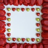 Valentines or Mothers Day Frame - Stock Photos. Valentines or Mothers Day Frame - tulips and chocolates : red tulip flowers and heart shaped candies on white royalty free stock images