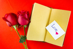 Valentines notebook with message card on red background Image of Stock Photos