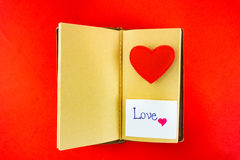 Valentines notebook with message card on red background Image of Stock Photo