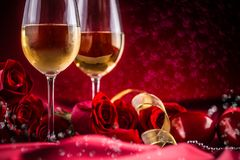 Free Valentines Or Wedding Concept. Wine Cups Red Roses And Romantic Stock Images - 107697524