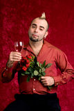 Valentines Portrait. A young man with a dozen red roses and a glass of wine royalty free stock photos