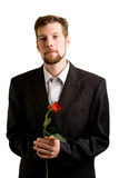 Valentines Portrait. A young man with a single red rose stock photo