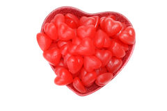 Valentines red heart chewy candy in bowl. Isolated valentines red heart chewy candy in bowl royalty free stock photo