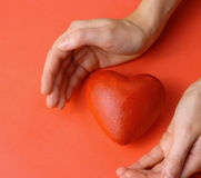 Valentines - red heart in hands Stock Photo