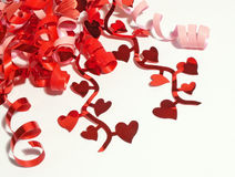 Valentines ribbon. Red and pink curling ribbon with hearts Royalty Free Stock Photos