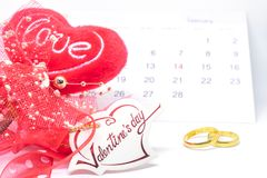 Valentines`s day, heart card love, calendar of February and ring on white background - selective focus. royalty free stock images