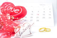 Valentines`s day, heart card love, calendar of February and ring on white background - selective focus. royalty free stock photography