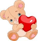 Valentines Teddy Bear. Holding love heart Royalty Free Stock Photo
