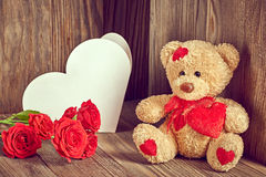 Valentines Teddy Bear Loving with Roses and greeting card Stock Image