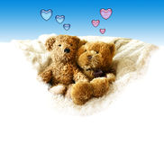 Valentines - Teddy bears. Two teddy bears sitting on the fur.The space at the bottom is pure white so you could easly make it bigger to fit your text Stock Image