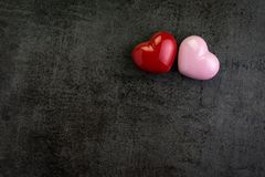 Valentines wallpaper or background with Red and pink heart shape. S on black cement walll or chalkboard with copy space Royalty Free Stock Photography