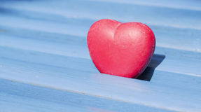Valentines wallpaper. Heart object between blue wooden planks Royalty Free Stock Photography