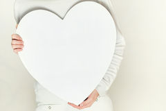 Valentines woman and heart symbol in hands - love Stock Image