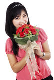 Valentines woman holding flowers smiling happy Stock Photography