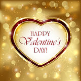 Valentinhjärta på guld- bakgrund Arkivfoto