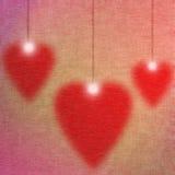 Valentinkort med tre röda hjärtor Royaltyfri Foto