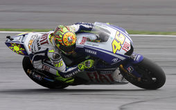 Valentino Rossi. Italy\'s MotoGP rider Valentino Rossi steers his Yamaha during a free practice Stock Image