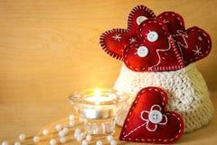 Valentinsgrüße mit Kerze Stockfoto