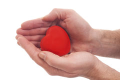 Valentinsgrüße - rotes Inneres in den Händen Lizenzfreie Stockbilder