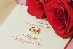 Valentinsgrüße schellen und Rose Stockbilder