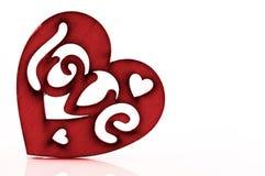 Valentinsgruß ` s Tageskarte - rotes Herz mit dem Wort Stockfotografie