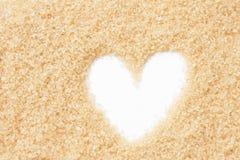 Valentinsgrußherz des süßen braunen Zuckers Stockfotografie
