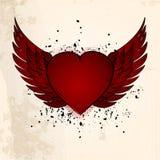 Valentinsgrußherz mit Flügelschmutzhintergrund stockbilder