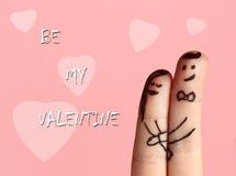 Valentinsgrußkarte mit zwei Fingern Stockfotografie