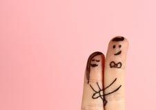 Valentinsgrußkarte mit zwei Fingern Lizenzfreies Stockfoto