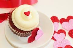Valentinsgrußkleiner kuchen Stockfoto
