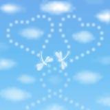 Valentinsgrußtageshintergrund mit Libellen Stockbilder