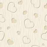 Valentinsgrußtagesnahtloses Muster mit Herzen schnitzte auf einem hölzernen Hintergrund Auch im corel abgehobenen Betrag Stockfotos