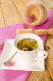 Valerian infusion. Homemade valerian infusion, with mortar and pestle in the background Royalty Free Stock Photos