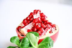 Valerian leaves and peeled pomegranate stock images