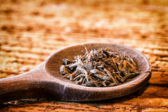 Valerian root. Incense on an old kitchen spoon - valerian root Royalty Free Stock Image