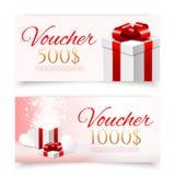 Vales de regalo del vector con las cajas de regalo Imagen de archivo