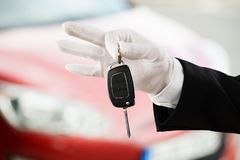 Valet Boy Hand Holding Car Key. Close-up Of A Valet Boy Hand Holding Car Key Outside The Car Royalty Free Stock Photo