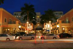 Valet Parking at Max`s Grill. This is a long time exposure of the valet parking area with passing cars creating blurs and streaks at Max`s Grill, Mizner Park Stock Images