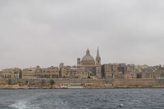 Valetta, historical center, capital city of Malta. Valetta, Capital city of Malta, and focused on historical core. Historical buildings visible from sea and city stock photo