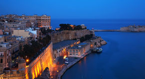 Valetta in dusk. Malta. Fortress wall of Valetta and Grand Harbour in dusk. Malta royalty free stock image