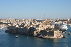 Valetta, Malta. Valetta Harbor on the island of Malta, Europe. Beautiful architecture of sand stone buildings and big cruise ship at anchor Royalty Free Stock Photos