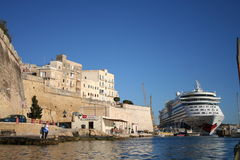 Valetta, Malta. Valetta Harbor on the island of Malta, Europe. Beautiful architecture of sand stone buildings and big cruise ship at anchor Stock Photos