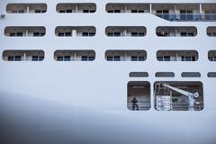 Crew member hanging on the railing of the cruise ship MSC Presioza royalty free stock image