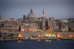 Valetta at dusk. Malta. Valetta and Marsamxett Harbour at dusk as viewed from Sliema. Malta Royalty Free Stock Image