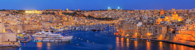 Valetta sunset in Malta. View to Great Harbor at sunset from Upper Barrakka Gardens, Valetta, Malta Stock Images